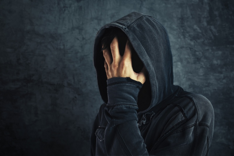 Hooded person fighting addiction crisis, drug or alcohol addict in abstinence period